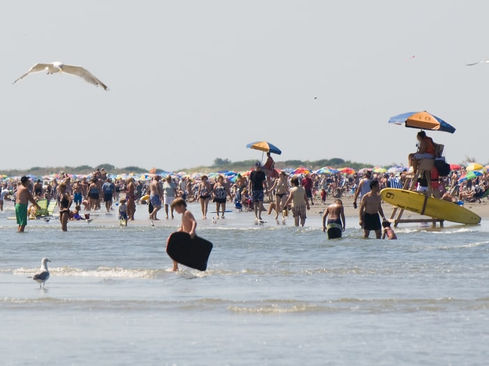 Tourists enjoying the water at the Jersey Shore.