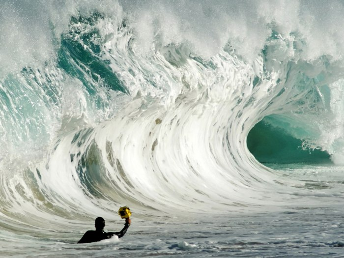 Clark Little braves a big wave to get the perfect shot.