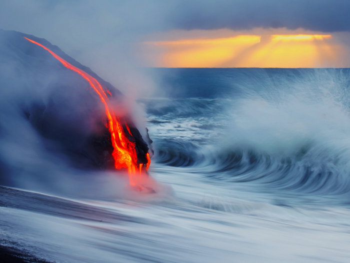 Photographers Nick Selway and C.J. Kale jumped into near-boiling water in swim trunks and fins to capture stunning images of lava colliding into a breaking wave at a volcano site on the island of Hawaii.