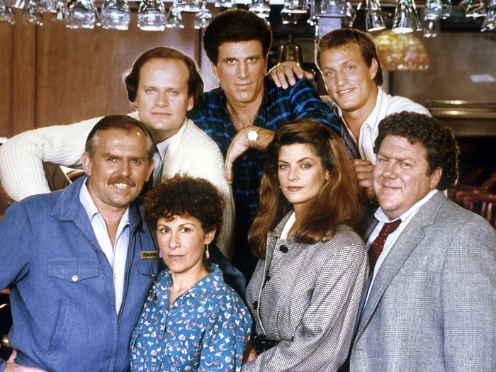 "Kelsey Grammer as Dr. Frasier Crane, Ted Danson as Sam Malone, Woody Harrelson as Woody Boyd, John Ratzenberger as Cliff Clavin, Rhea Perlman as Carla Lozupone Tortelli LeBec, Kirstie Alley as Rebecca Howe, George Wendt as Norm Peterson in ""Cheers."""