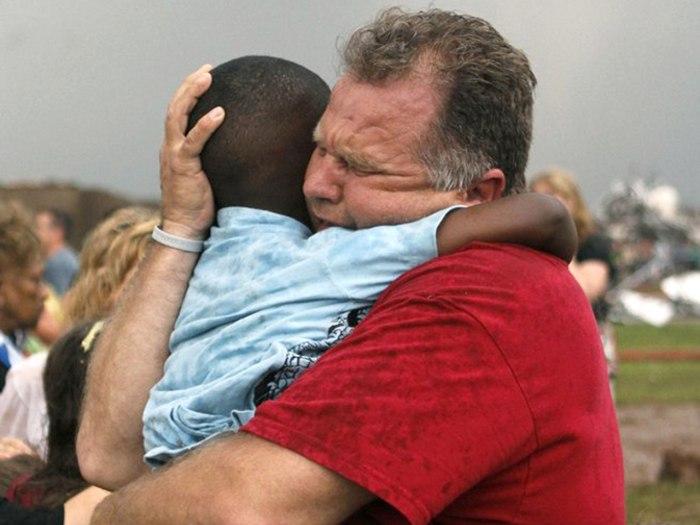 Image: Teacher hugs student
