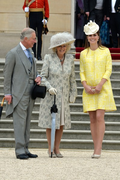 Prince Charles, Camilla, the Duchess of Cornwall, and Duchess Kate attend a party in the grounds of Buckingham Palace.