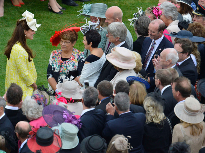 Duchess Kate attends a garden party at Buckingham Palace in London.