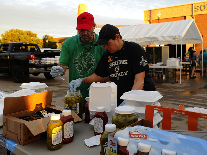 Volunteers from Mercy Chefs prepare food for tornado victims on May 21, 2013 in Moore, Oklahoma. Families returned to a blasted moonscape that had bee...