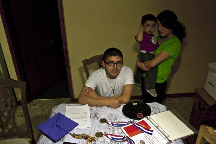 CHICAGO, IL: Francisco Peralta, 17, at home with his sister Jacqueline Peralta, 13, and brother Miguel. Peralta, an undocumented student, is at the to...