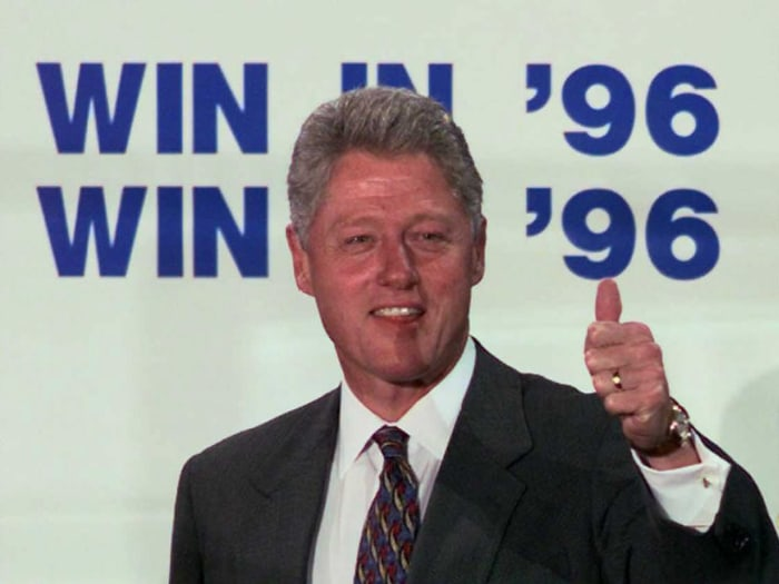 President Bill Clinton signals a thumbs-up to a cheering crowd gathered in downtown Chicago's Daley Plaza.