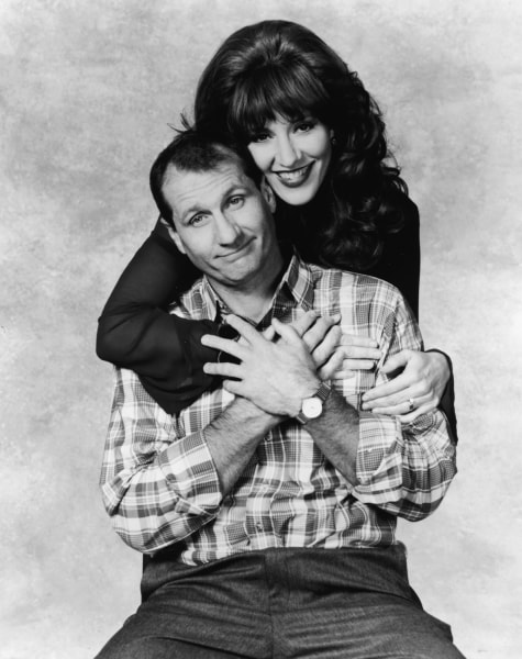 "Ed O'Neill and Katey Sagal in a promotional shot for ""Married With Children."""