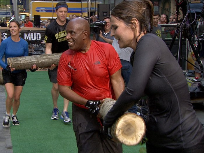 Tough Mudder is all about teamwork, especially when carrying logs, as Al and Savannah demonstrate.
