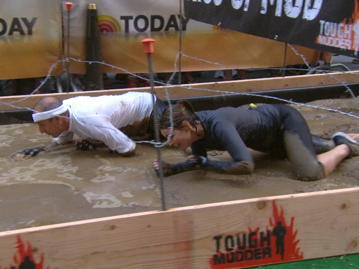 It wouldn't be Tough Mudder without, you know, mud. Savannah and Matt ruin their outfits with this barbed wire obstacle.