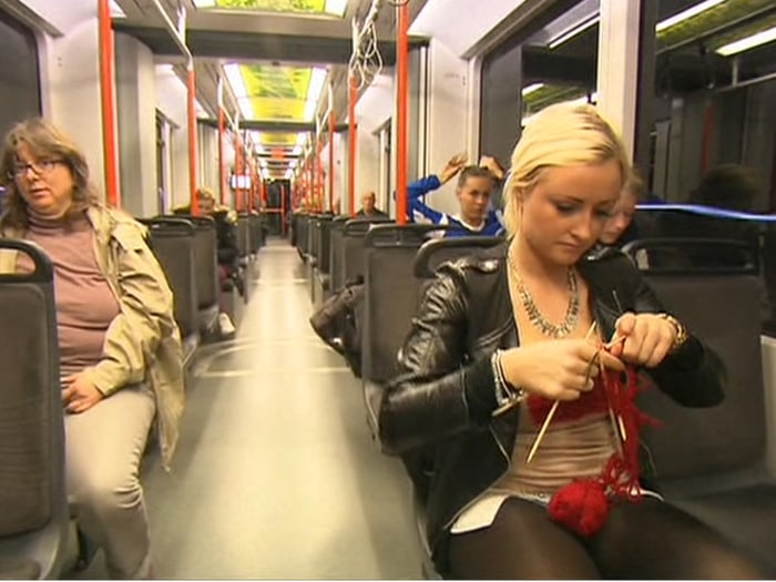 Woman knitting on a train