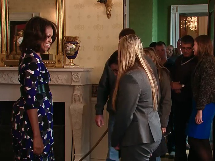 Mrs. Obama greeted unsuspecting guests Tuesday as White House tours resumed.