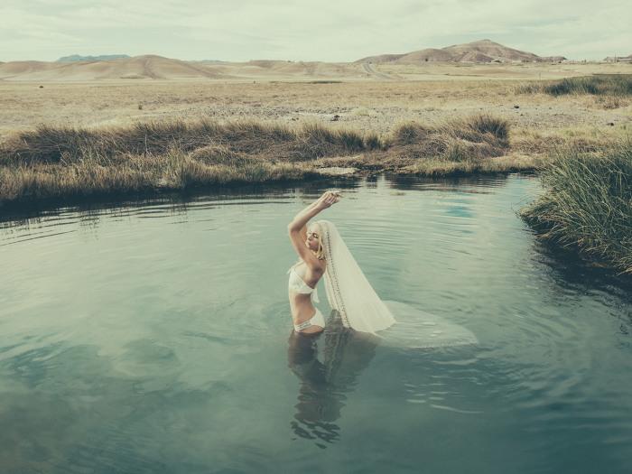 Image: Model wearing a Mara Hoffman bridal bikini in the water