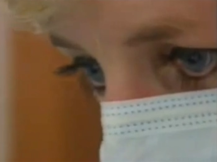 Princess Diana observing a surgery.