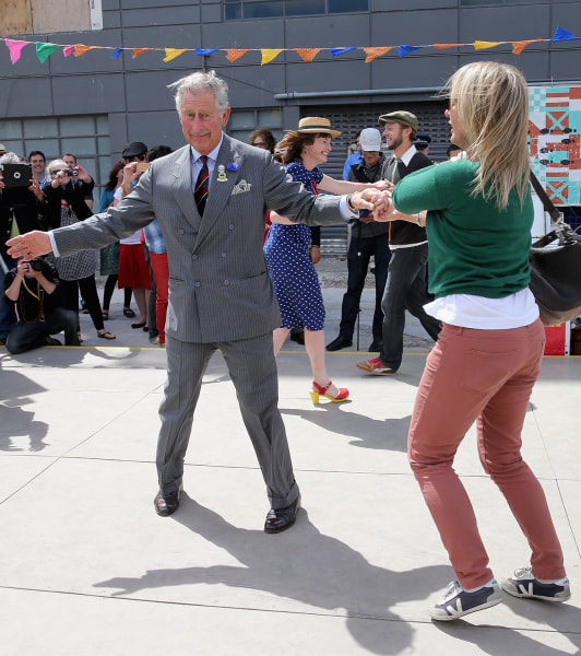 Prince Charles, Prince of Wales and Lisa Shannon (R)  dance at the Dance-O-Mat during a visit to Christchurc...