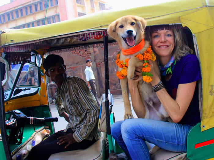 Image: Joanne Lefson with Rupee the dog in a tuk tuk.