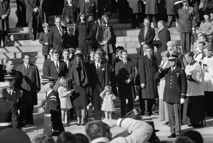 25 Nov 1963, Washington, DC, USA --- Original caption: Like a little soldier, John F. Kennedy Jr. who celebrates his 3rd birthday, salutes at the cask...