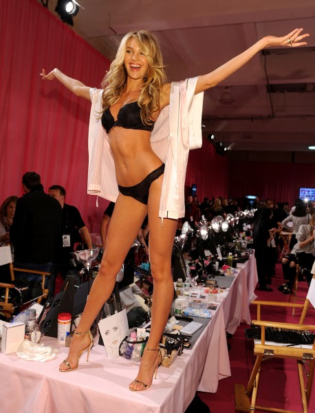 NEW YORK, NY - NOVEMBER 13:  Model Candice Swanepoel poses at the 2013 Victoria's Secret Fashion Show hair and make-up room at Lexington Avenue Armory...