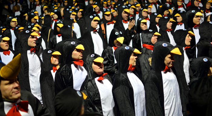 The largest gathering of people dressed as penguins is 325, and was achieved by members of the Richard House Children's Hospice in Wood Wharf, London, England, for Guinness World Records Day 2013, the international day of record breaking.