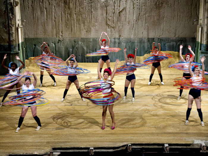 The most hula hoops spun simultaneously by a team is 264 and was achieved by Marawa the Amazing and her Majorettes at the Shaftesbury Theatre, London, on 14 November 2013.