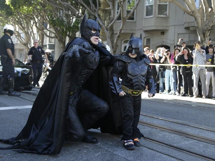 Miles, aka, Batkid walks with Batman before saving a damsel in distress in San Francisco.