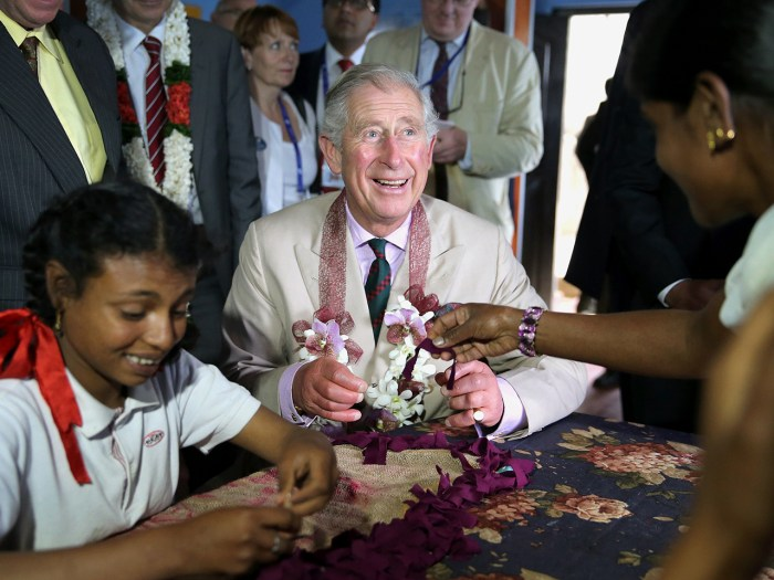 NUWARA ELIYA, SRI LANKA - NOVEMBER 16:  Prince Charles, Prince of Wales takes part in arts and crafts with disabled children as he visits MEDCAFEP Day...