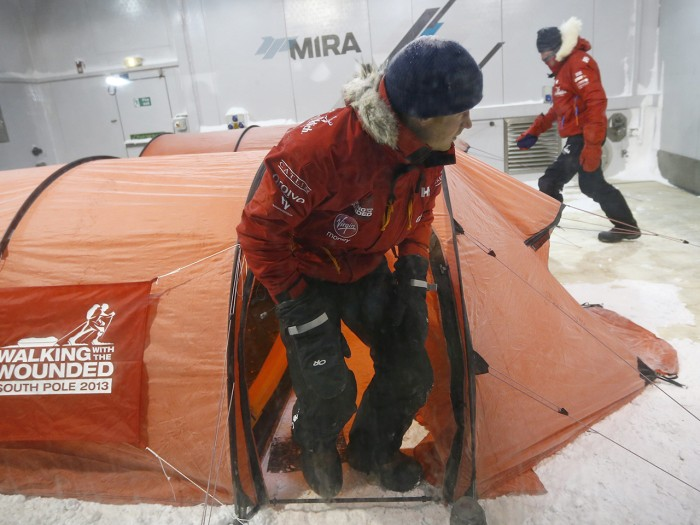 Britain's Prince Harry leaves his tent during a cold chamber training exercise with the Walking with the Wounded South Pole Allied Challenge 2013 Brit...