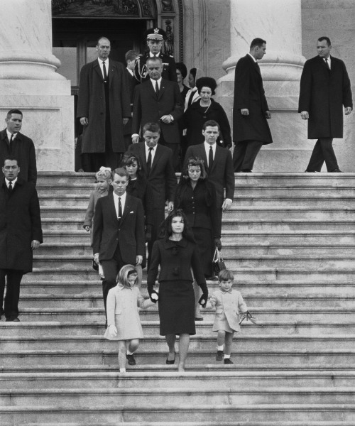 Kennedy family members descend steps in Washington, Nov. 25, 1963, at the funeral for President John F. Kennedy. From front to back at left are: Caroline Kennedy, Jacqueline Kennedy and John Kennedy Jr.; behind them, Robert F. Kennedy, Patricia Kennedy Lawford and her husband, Peter Lawford; Little Sydney Lawford is at left of her mother. Behind Mrs. Kennedy are Jean Kennedy Smith and her husband Stephen E. Smith. Near top are President Lyndon B. Johnson and his wife Lady Bird Johnson. Behind the vice president is the chairman of the Joint Chiefs of Staff, Maxwell D. Taylor.
