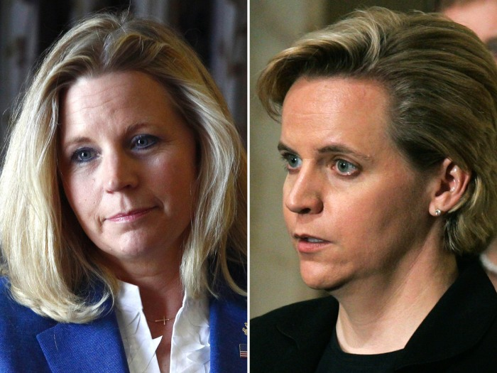 FILE - In this July 17, 2013, file photo, Liz Cheney, left, speaks during a campaign appearance in Casper, Wyo., and her sister Mary Cheney, right, is...