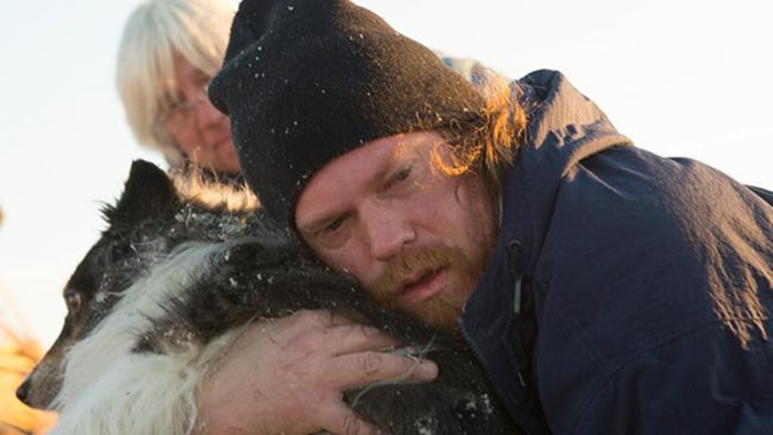 Illinois man Jon Byler Dann was reunited with his family's dog, Maggie, after she somehow survived a tornado that destroyed their home.