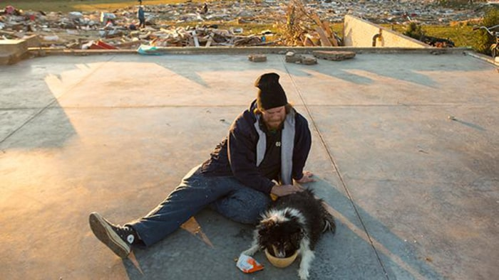 "Dann said it was ""unreal'' that the family dog made it through the tornado, which Dann survived while huddled with his four children in the basement bathroom as it destroyed their home."
