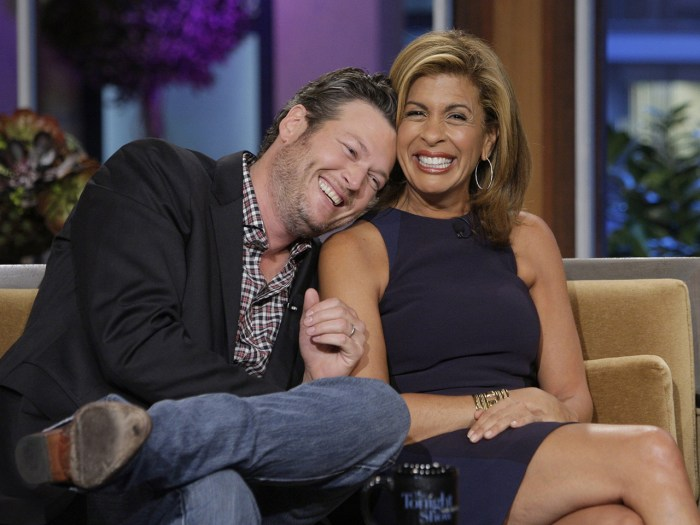 "There's no denying the chemistry between these two. Country singer Blake Shelton and Hoda Kotb cozy up while appearing on Jay Leno's ""The Tonight Show."""