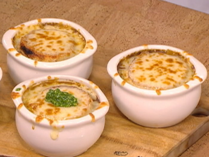 Vidalia onion soup with blistered Vermont cheddar cheese and parsley pesto