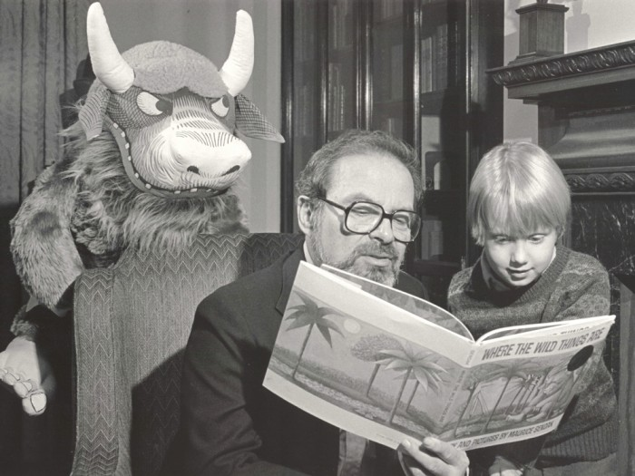 Author Maurice Sendak reads his signature work with a young fan at the Rosenbach Library and Museum in Philadelphia, Pennsylvania in 1985.