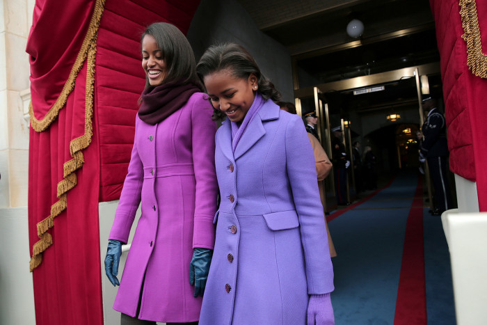 WASHINGTON, DC - JANUARY 21:  (L-R) Malia Obama and Sasha Obama arrive during the presidential inauguration on the West Front of the U.S. Capitol Janu...
