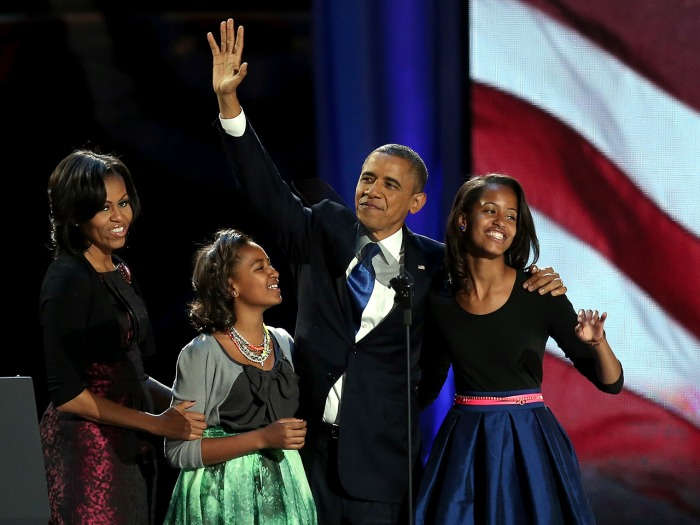 CHICAGO, IL - NOVEMBER 06:  U.S. President Barack Obama walks on stage with first lady Michelle Obama and daughters Sasha and Malia to deliver his vic...