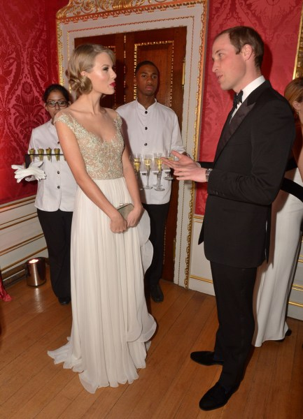 LONDON, ENGLAND - NOVEMBER 26:  Prince William, Duke of Cambridge meets singer Taylor Swift at Kensington Palace for the Centrepoint Winter Whites Gal...
