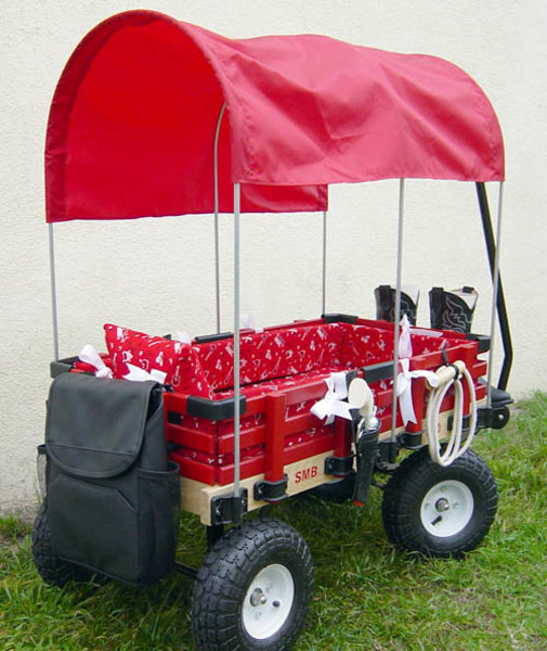 not your father 39 s red radio flyer luxury kid wagons boast custom wheels dvd players. Black Bedroom Furniture Sets. Home Design Ideas
