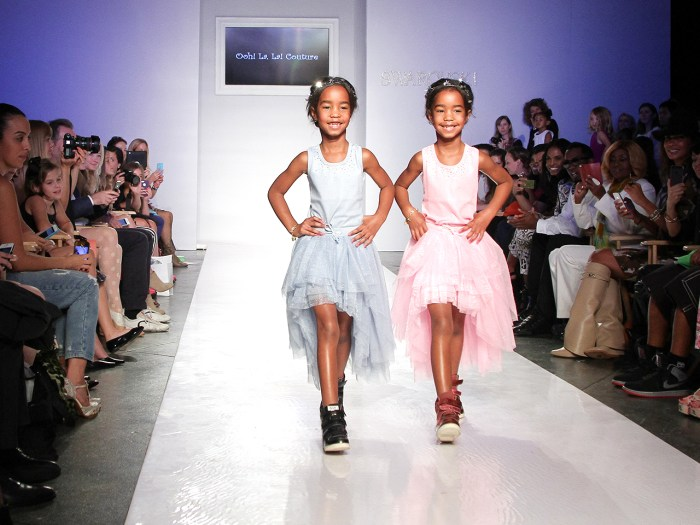 NEW YORK, NY - OCTOBER 05: Jesse Combs and D'Lila Combs walk the Ooh! La La! preview during the Swarovski at petiteParade NY Kids Fashion Week in Coll...