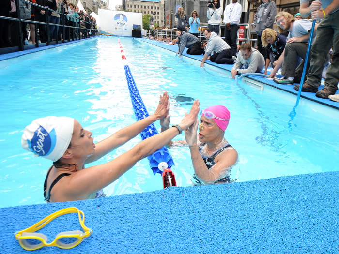 "NEW YORK, NY - OCTOBER 09:  Natalie Morales and Diana Nyad swim during ""Swim for Relief"" Benefiting Hurricane Sandy Recovery - Day 2 at Herald Square ..."