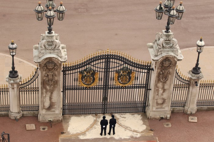 LONDON, ENGLAND - APRIL 29: Two police officers stand guard at the gates of Buckingham Palace following the marriage of Prince William, Duke of Cambri...