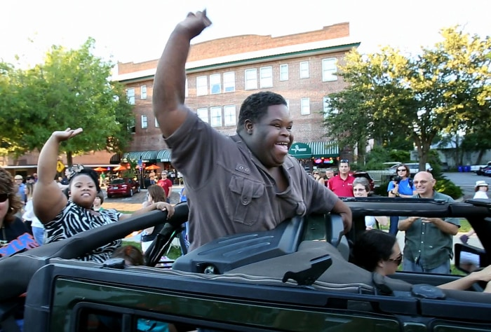 Bubba Hunter, right, and Semone Adkins, both homecoming king candidates for West Orange High, are the stars of the homecoming parade in downtown Winte...