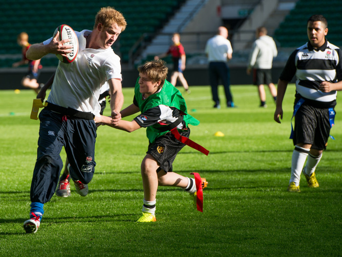 Image: Prince Harry playing football