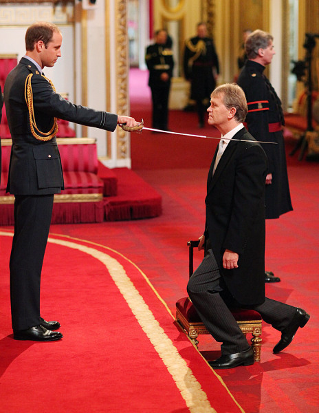 Headteacher Sir Kenneth Gibson from Jarrow receives his Knighthood from Prince William, Duke of Cambridge, during an Investiture ...