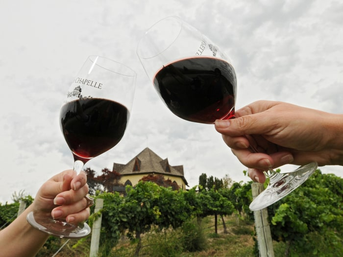 In this undated photo, people hold wine glasses containing 2012 Cabernet Sauvignon at Sunnyslope's Ste. Chapelle Winery in Caldwell, Idaho. Agritouris...