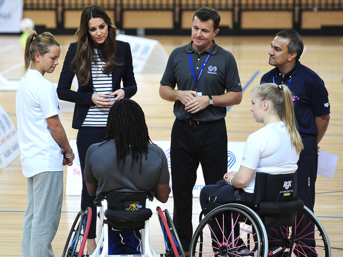 Britain's Catherine, Duchess of Cambridge (2-L) speaks with athletes during a trip to the SportsAid Athlete Workshop in the Copper Box at the Queen El...