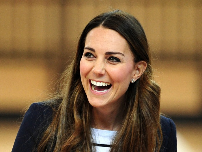 Britain's Catherine, Duchess of Cambridge laughs after participating in a volleyball game during a trip to the SportsAid Athlete Workshop in the Coppe...