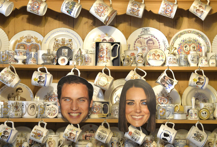 Image: A kitchen cabinet covered in commemorative crockery and face masks of Britain's Prince William and Duchess Kate can be seen at the London home of royal-family fan Margaret Tyler.