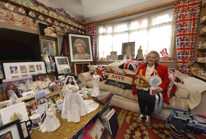 Image: Margaret Tyler sits in the front room of her London home, which she's transformed into a shrine to Britain's royal family.