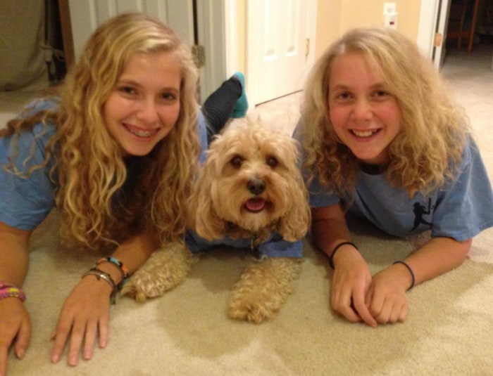 Rachel and Jamie Lipson pose with their pup, Rocky.