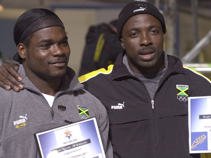 "Former Jamaican bobsled team member Lascelles ""King"" Brown (left), who now competes for Canada, helped convince his good friend and former teammate, Winston Watts (right), to come out of retirement to try to make the Sochi Olympics in the two-man bobsled for Jamaica."